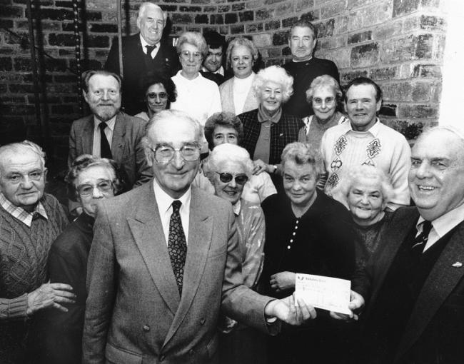Skipton Hospital Friends hand a cheque to Airedale Health Authority chairman Donald Hanson in the 1990s