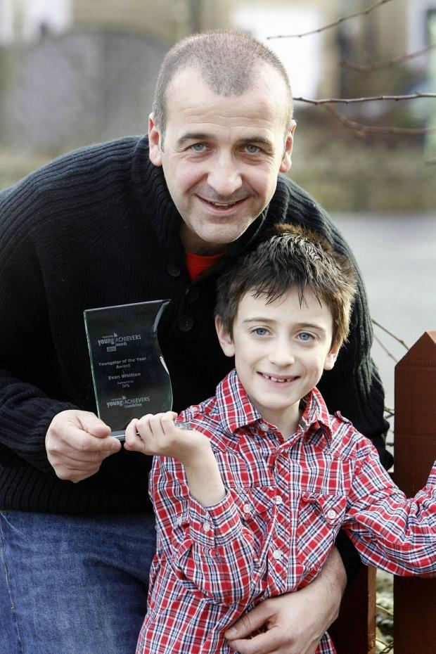 Evan Whitton with his Yorkshire Young Achievers Award and his dad, Andrew