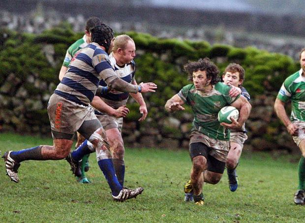 BATTLE OF DALES: Dan Solomi in possession for the Greens in their bad defeat
