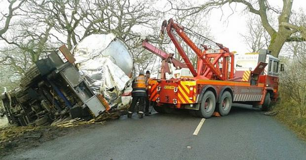 A tanker carrying 27,000 litres of milk, is lifted back onto the road after the accident on the B6265 road near Rylstone