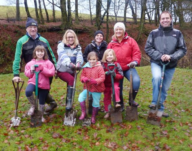 Children Sophie Smith, Tess Lewis and Harriet Howden with Richard Smith, Jo Lewis, Sarah Thompson, Caroline and Neil Howden at the community planting day in Lothersdale
