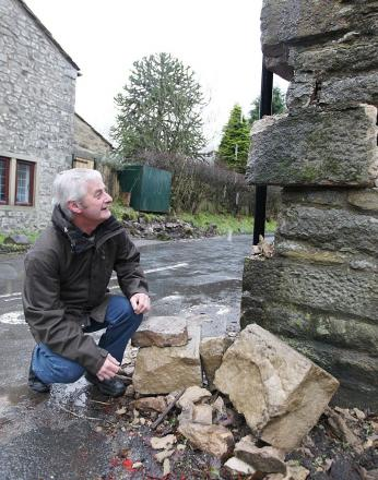 Long Preston councillor Chris Moorby inspects the damaged barn