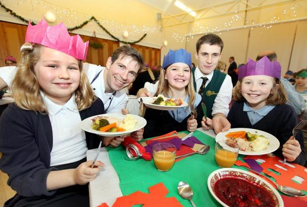 Chef Bruce Elsworth with pupils Millie Haggas, Hannah Wade and Amelia Ball and Angel waiter George Oversby