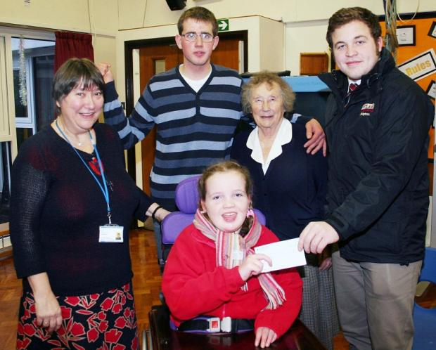 Sam Bradley, right, presents the charity cheque to Brooklands pupil Annabel, joined by, from left, headteacher Denise Sansom, George Throup and Shirley Mason