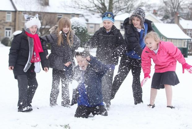 Sutton Cof E Primary School pupils Lucy Minikin, Aimee Felgate, Thomas Bielby, Joshua Page and Grace Harney throwing snowballs at George Robertson