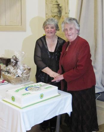 lub president Cathie Cromarty and founder member Phyllis Bowker cut a celebration cake
