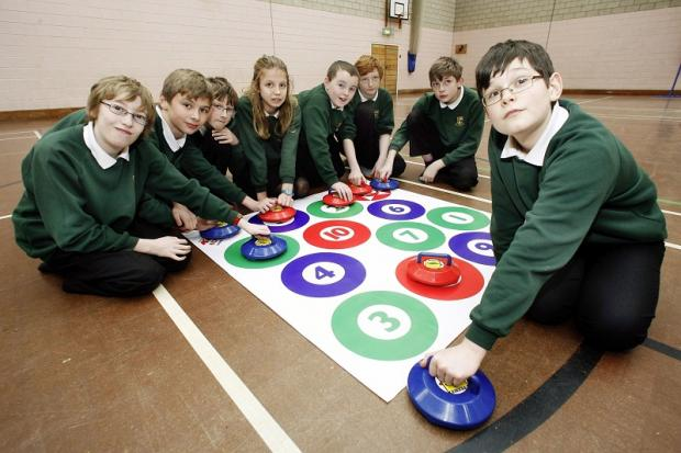 Students at South Craven School join in a game of curling