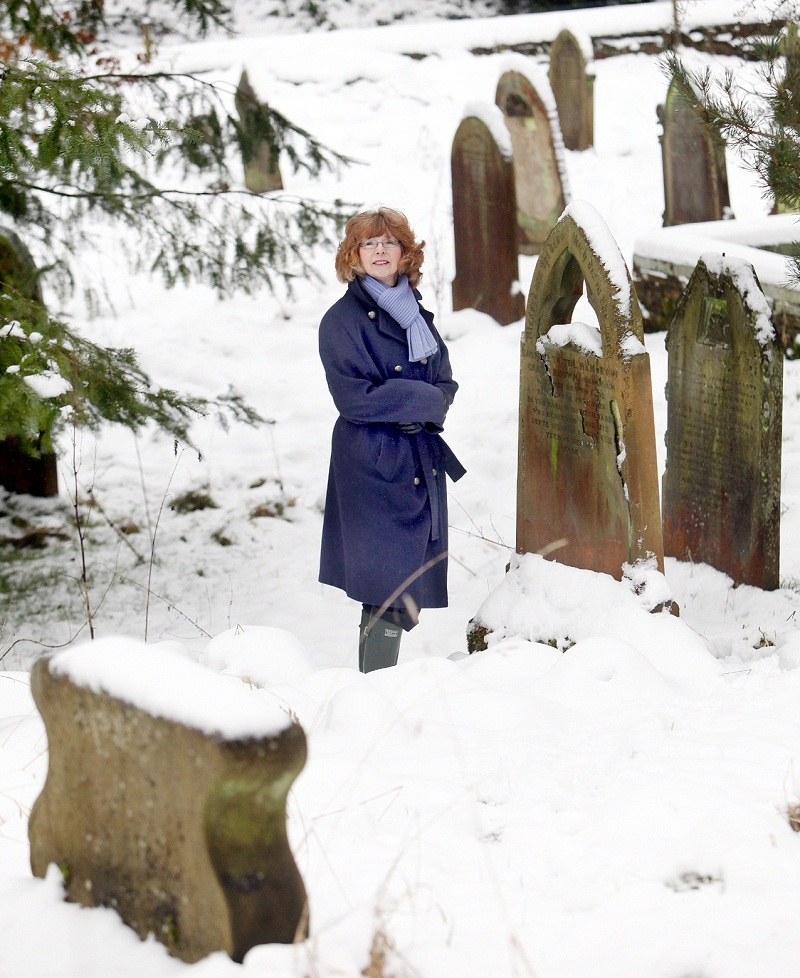 Jean Robinson viewing Rudyard Kipling's grandfather's grave. The Friends of Raikes Graveyard, Skipton, want to renovate the historic graveyard. See Alice Robinson's letter