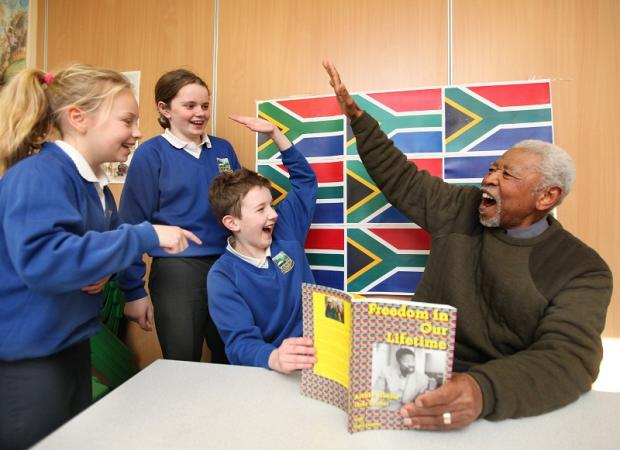 Zola Zimbe meets Settle Primary School pupils Elizabeth Henderson, Chloe Fawcett and Joseph Binns