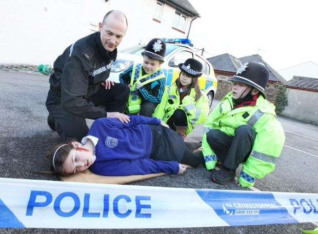 PC Laurence Martin re-enacts a traffic accident with Clapham Primary School pupils Erin Moorhouse, Nelson Woodhouse, Ella-Jayne North and Matthew Holroyd