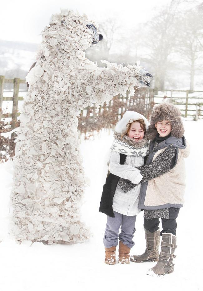 Lucy Whitehead and Sam Greenwood with a 10-foot polar bear made by pupils at Boyle and Petyt Primary School in Beamsley