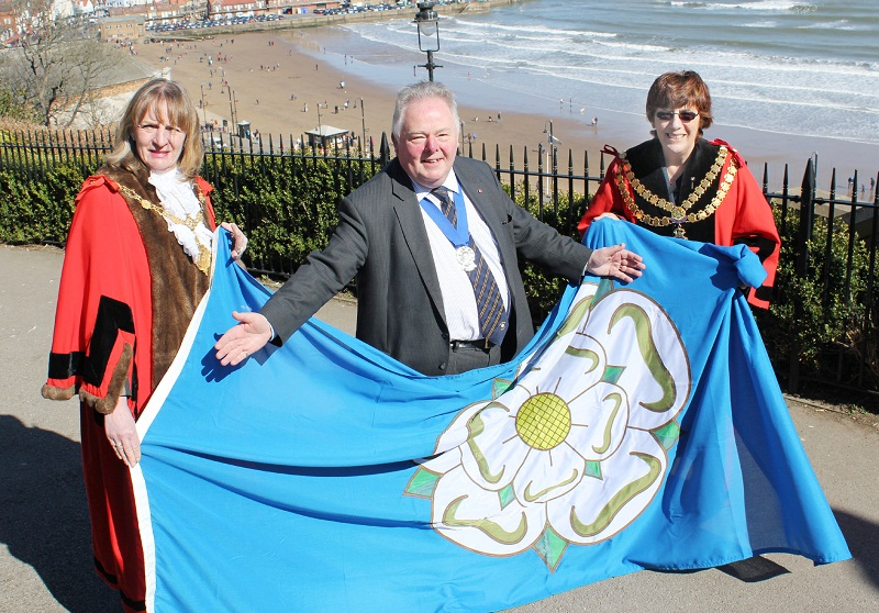 Pictured with the new Yorkshire Day flag are, from left, Mayor of Scarborough Coun Helen Mallory, chairman of the Yorkshire Society Keith Madeley and Coun Wendy Clark, Skipton Town Mayor