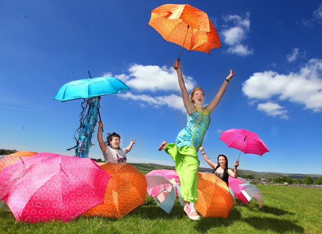 Carine Brosse, Bryony Pritchard and Emma Bayliss with some of the brollies