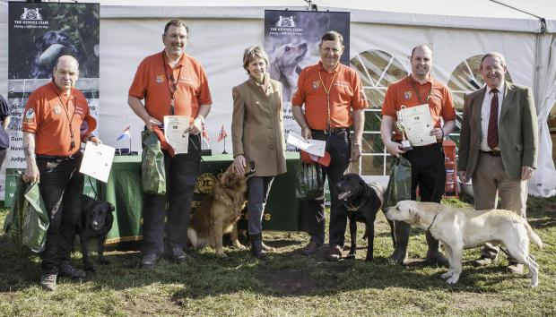 The UK team Stan Payne, Andrew Fisher, the Duchess of Devonshire, John Halsted, Richard Johnston (team captain) and Kennel Club chairman Steve Dean