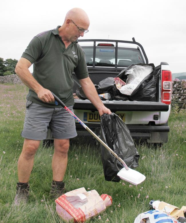 National Park Authority Lower Wharfedale Access Ranger Richard Mainman deals with litter
