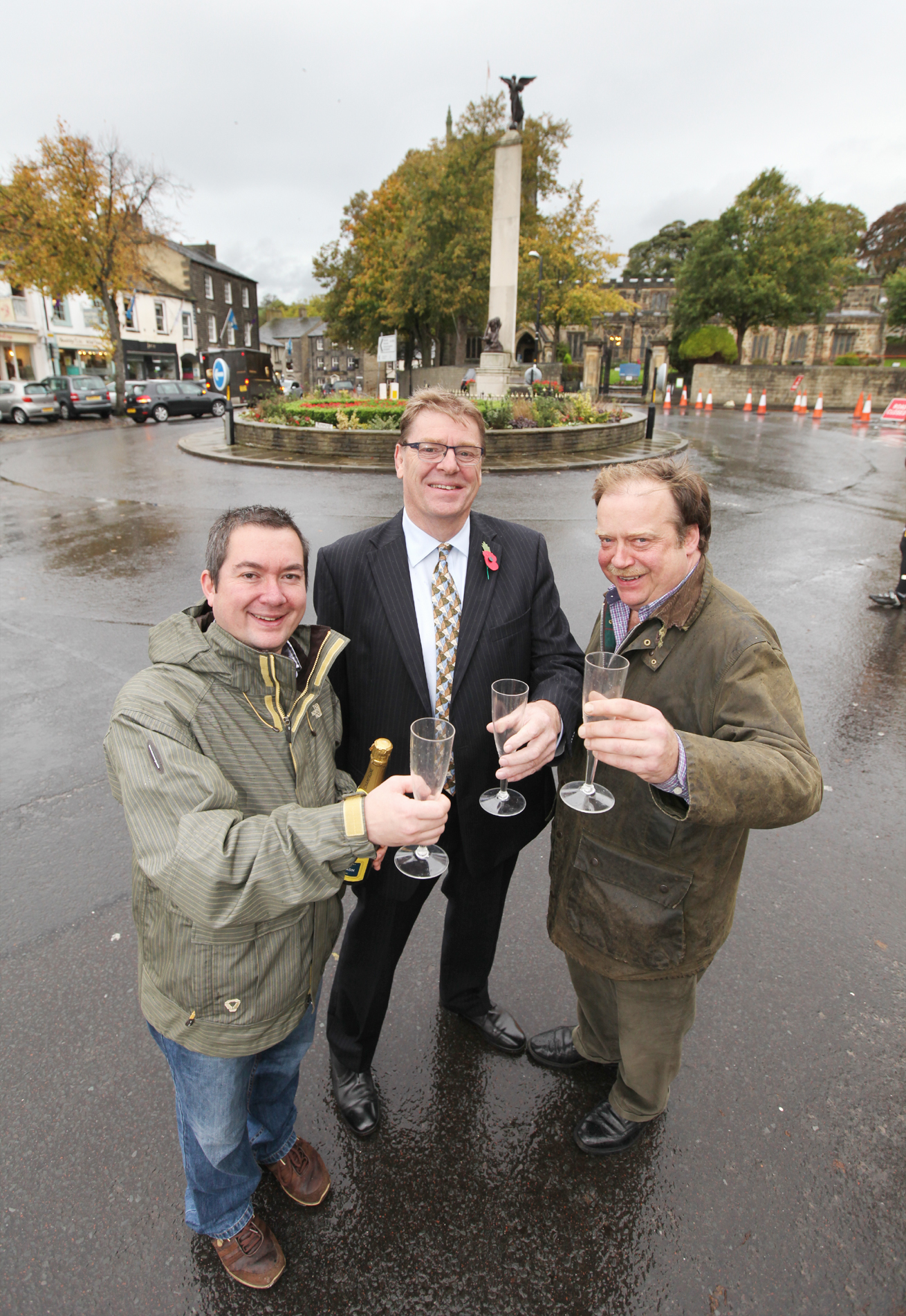 Chris Harbron, Dave Wathen and Simon Myers toast the arrival in Craven of the Tour