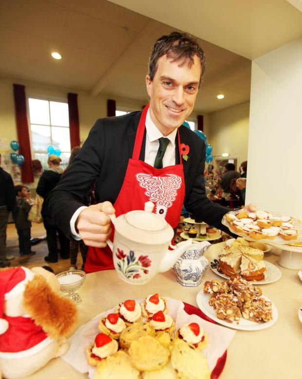 Craven Herald: MP Julian Smith serving tea at the Christmas Market