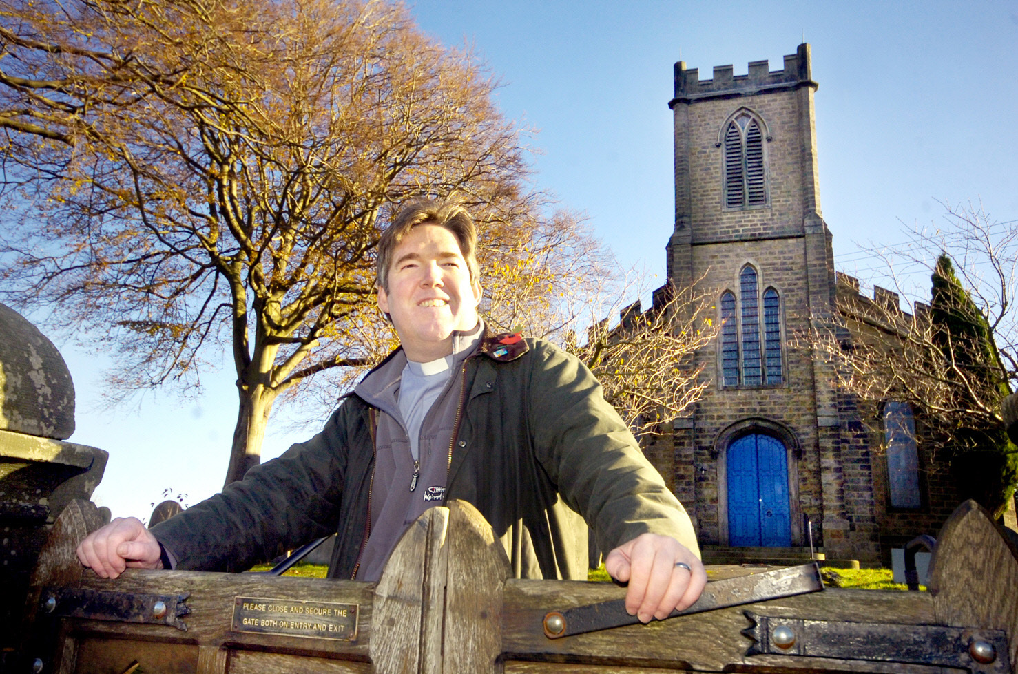 Former vicar of St Margaret's Church the Rev Clive Burgess stands outside the church in 2011 when the closure was first closed
