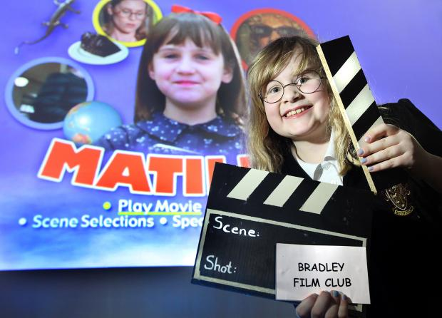 The launch  of the new school and community film club showing Eloise Kirwin with clapper board in hand