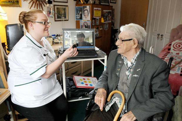 Craven Herald: Sutton Lodge resident Ernest Towers with nurse Jenny Beighton