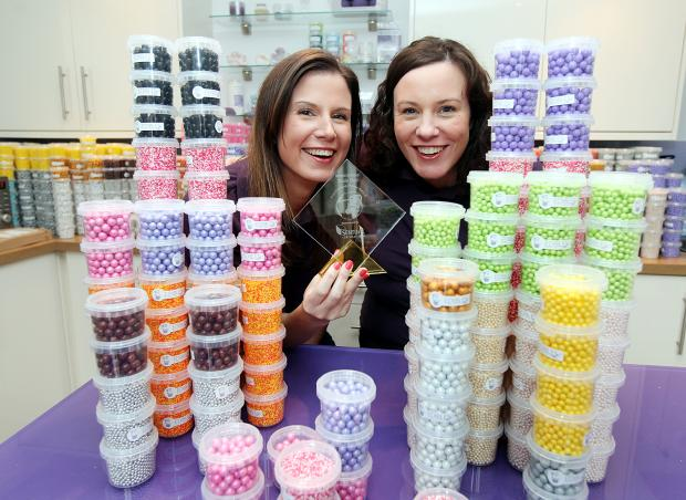 Craven Herald: Purple Cupcakes owners Fiona and Stephanie Clarke celebrate after their shop's award