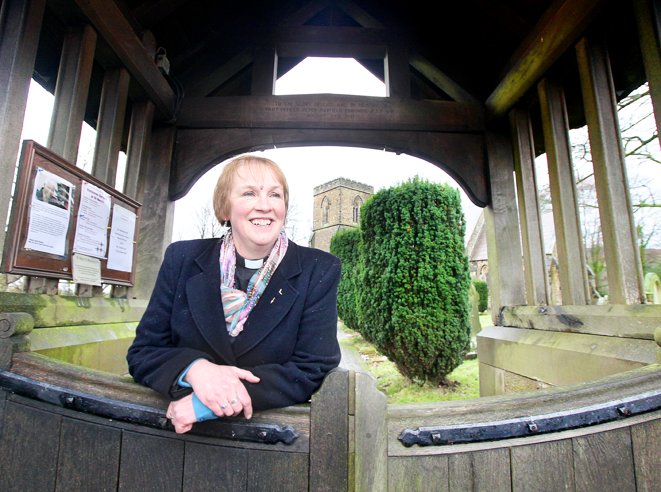 The Rev Louise Taylor-Kenyon at the entrance to St Mary's Church