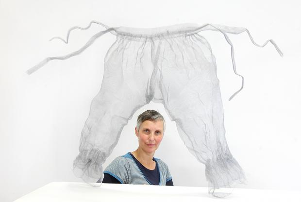 Artist Marjan Wouda with her sculpture of bloomers