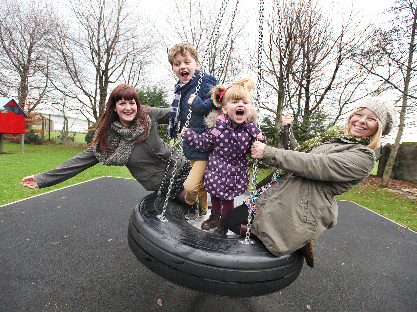 Launching a campaign to improve Gargrave play area are mums Gemma Tetley, left, and Sarah Pawson with Vincent and Poppy Tetley