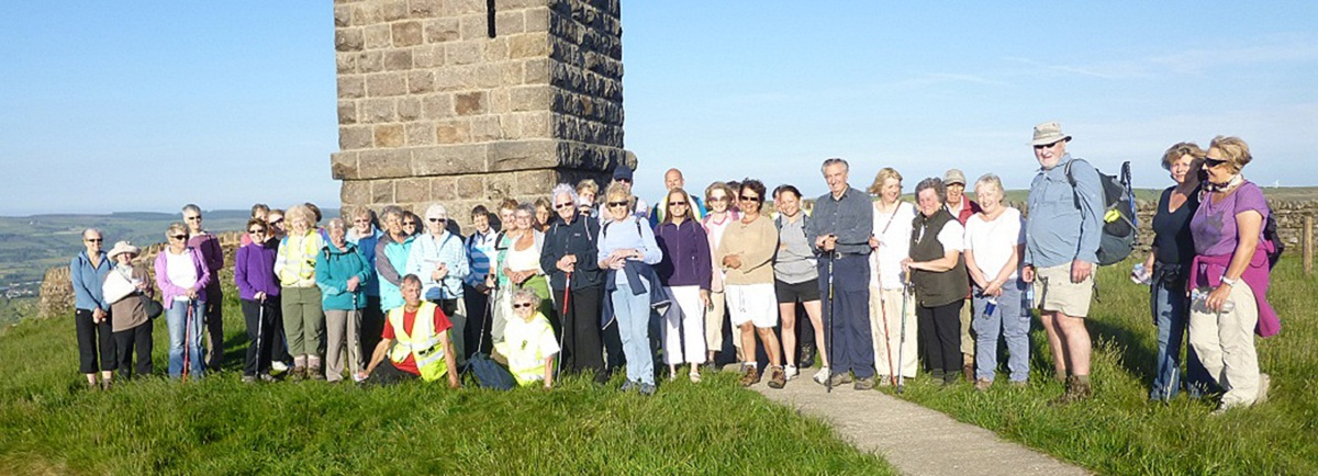 The South Craven Walking 4 Health group enjoys a summer walk to Lunds Tower