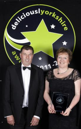 Charity Big Breakfast hosts Chris and Christine Ryder are pictured after receiving their 2011/12 Deliciouslyorkshire Best Yorkshire Breakfast award