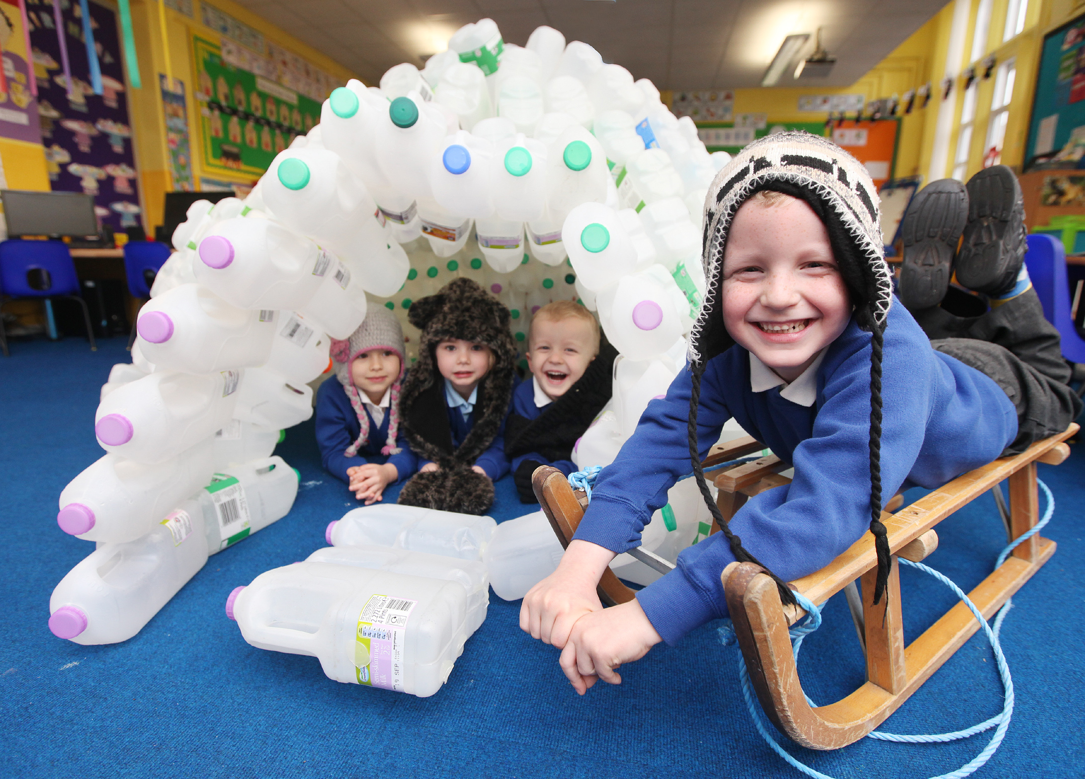Christ Church Primary School pupils Hania Keska, Rosie Fawcett, Dylan Clos and Alfie Loudon take a close look at the igloo