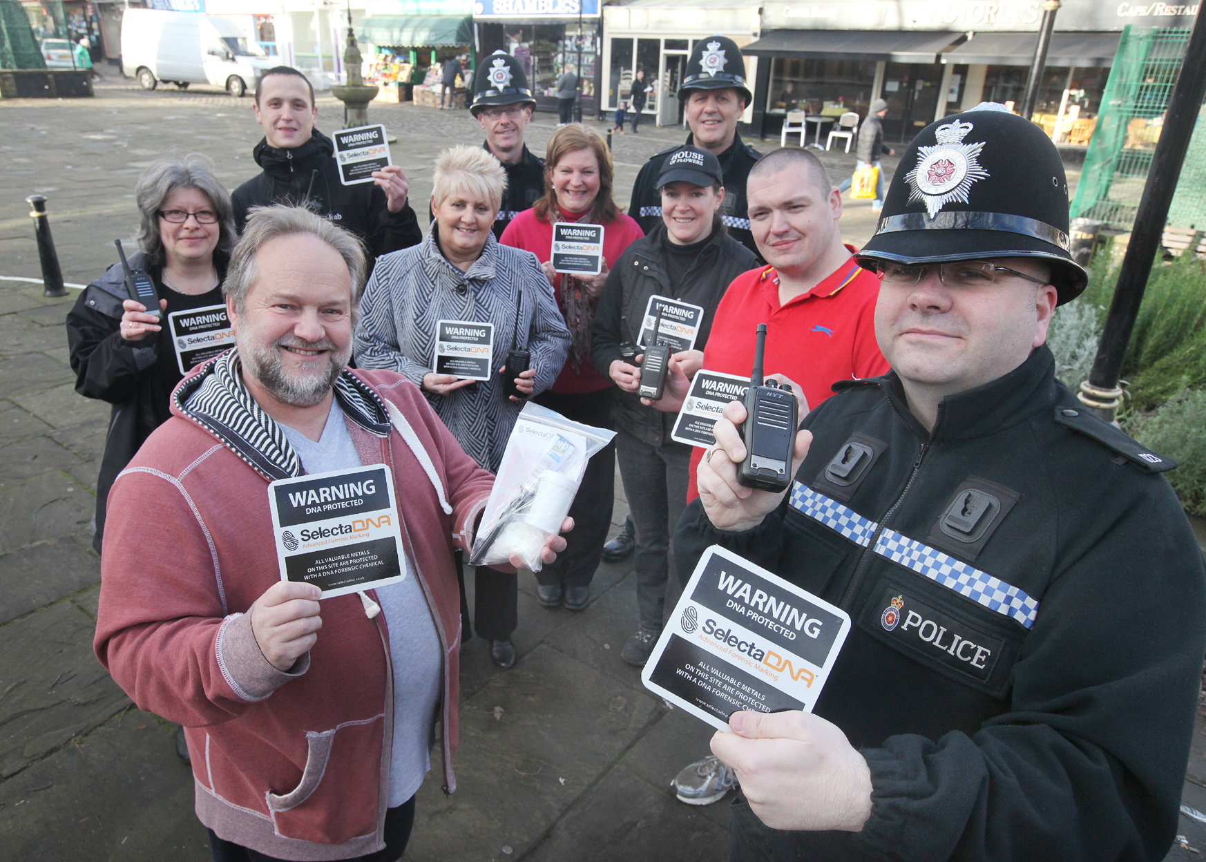 Coun David Whipp and PC Matt Lunney join traders to launch a new security initiative in Barnoldswick