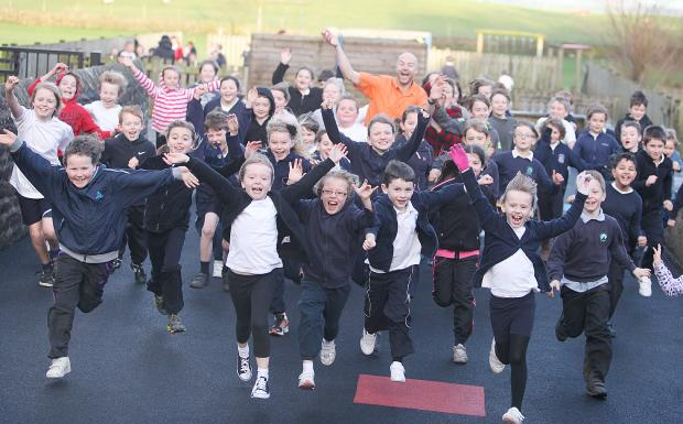 Craven Herald: Bentham runner and motivational speaker Andy Mouncey visited Cowling Primary school to talk about his run