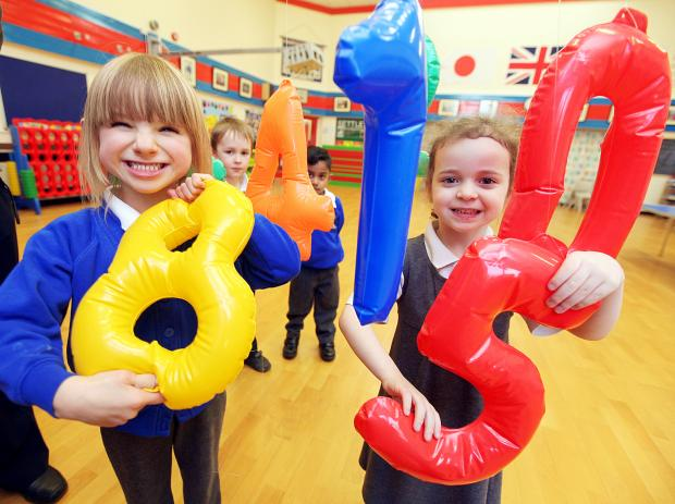 Settle Primary School pupils Sophie White and Isabelle Harrison get to grips with numbers