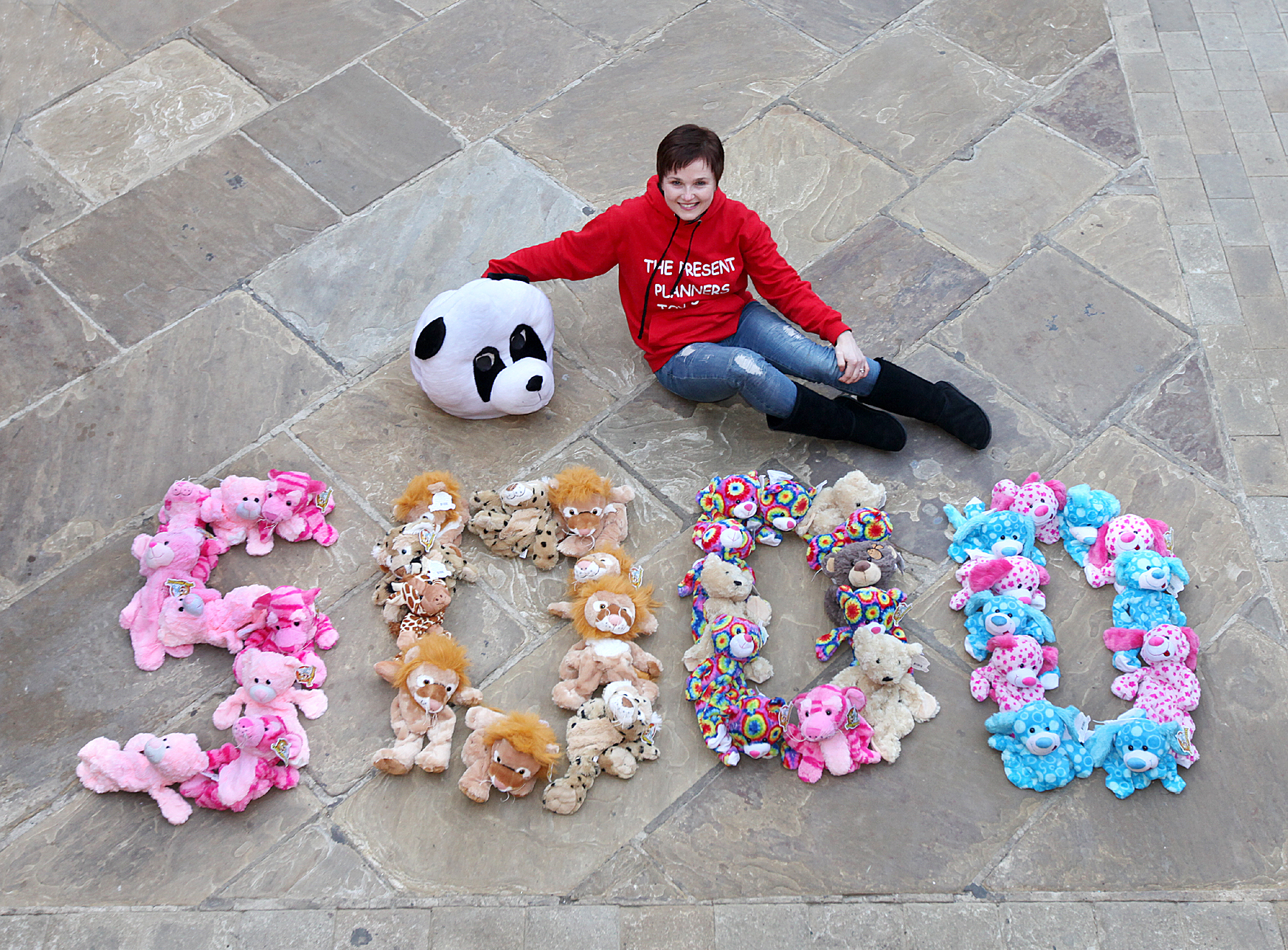 Owner Lisa Dyson celebrates her teddy bear landmark with a 5,000 motif made of toys
