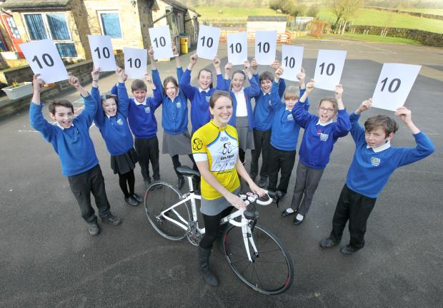 Craven Herald: Embsay Primary School teacher Alison Bell has set herself 10 fundraising challenges to complete in six months to raise money for Brain Tumour Research