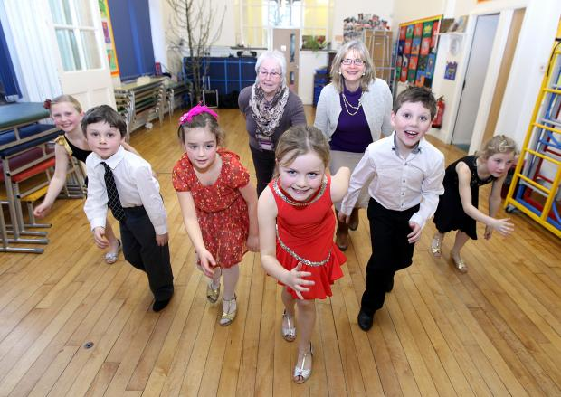 Pupils demonstrate their dance steps at the tea dance