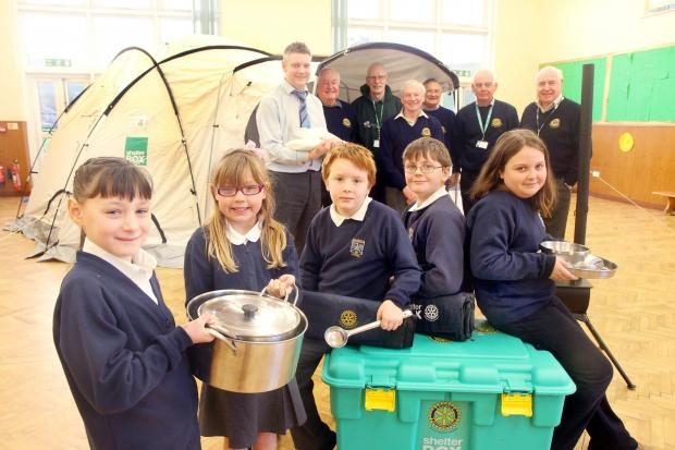 Glusburn Primary School headteacher Richard Hunt, back left, joins children from the school and members of Skipton Rotary with the Shelterbox equipment