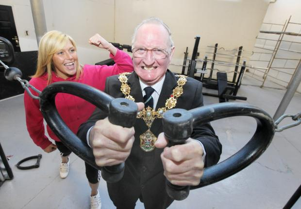 Mayor of Pendle, Coun Smith Benson, uses the chest press machine at Earby Fitness Mill. He is pictured with instructor Dianne Boyle