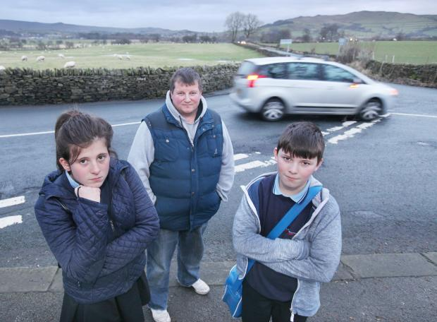 Craven Herald: Stuart Pighills with his children Emma and Jack