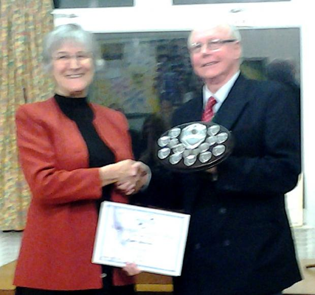 Judith Allinson is  awarded the Area Shield by area president Chris Birch