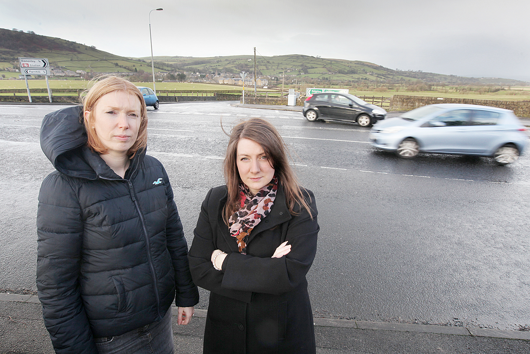 Cononley and Farnhill councillors Lois Brown and Gemma Harling at the Cononley Lane Ends Junction