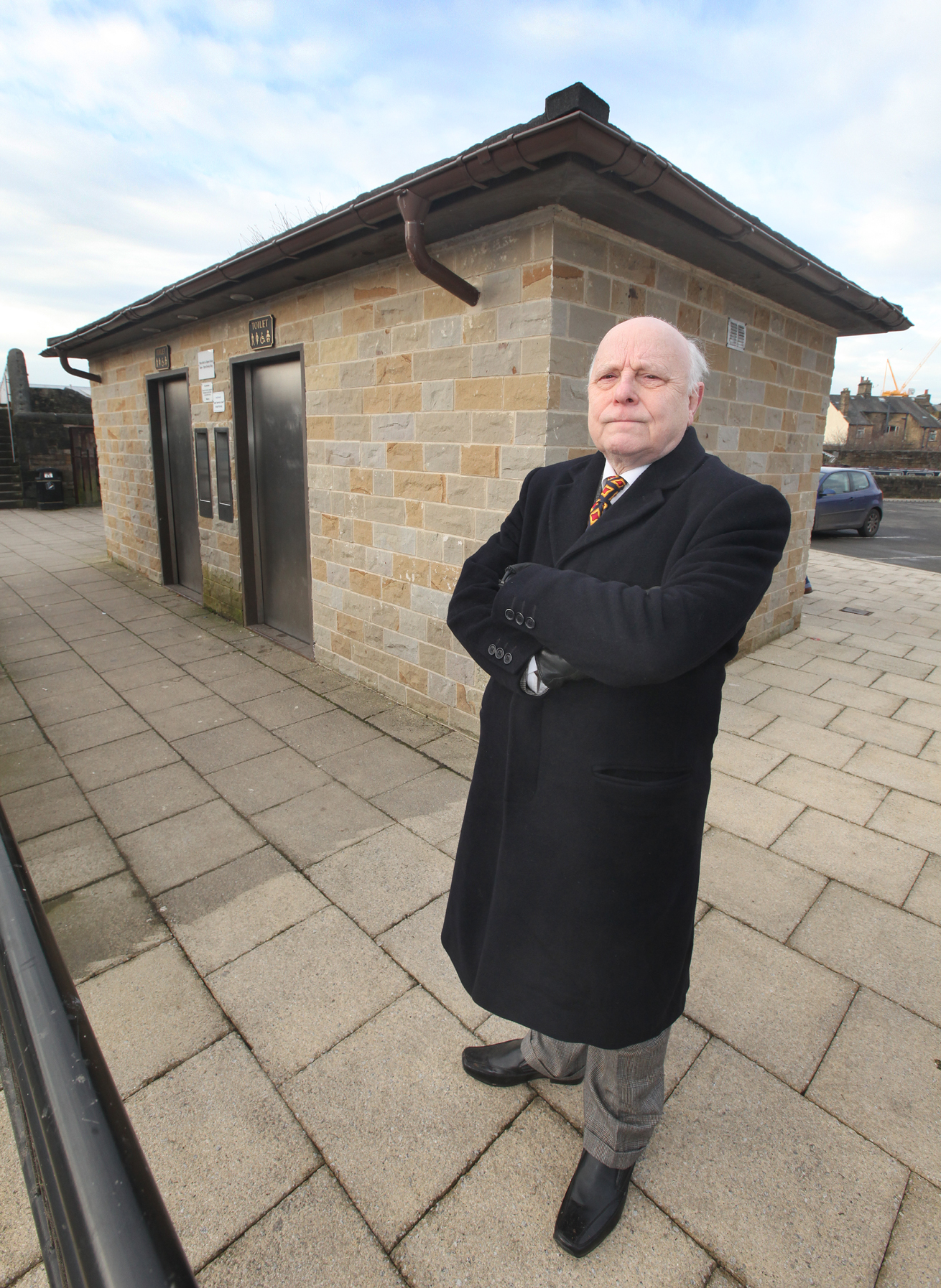 Mayor of Skipton Coun John Kerwin-Davey stands in front of the bus station toilets