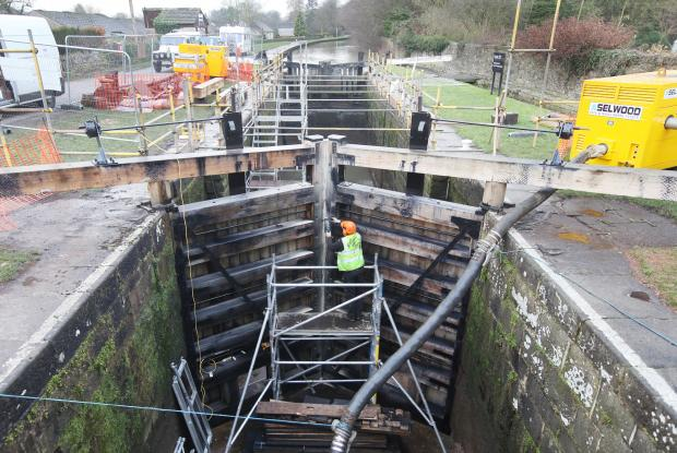 Workmen  repair and restore the lock gates on the Leeds and Liverpool Canal at Gargrave