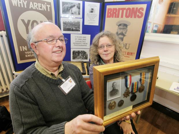 Pictured with First World War items at  Earby Community Centre are Bob Abel and Wendy Faulkner