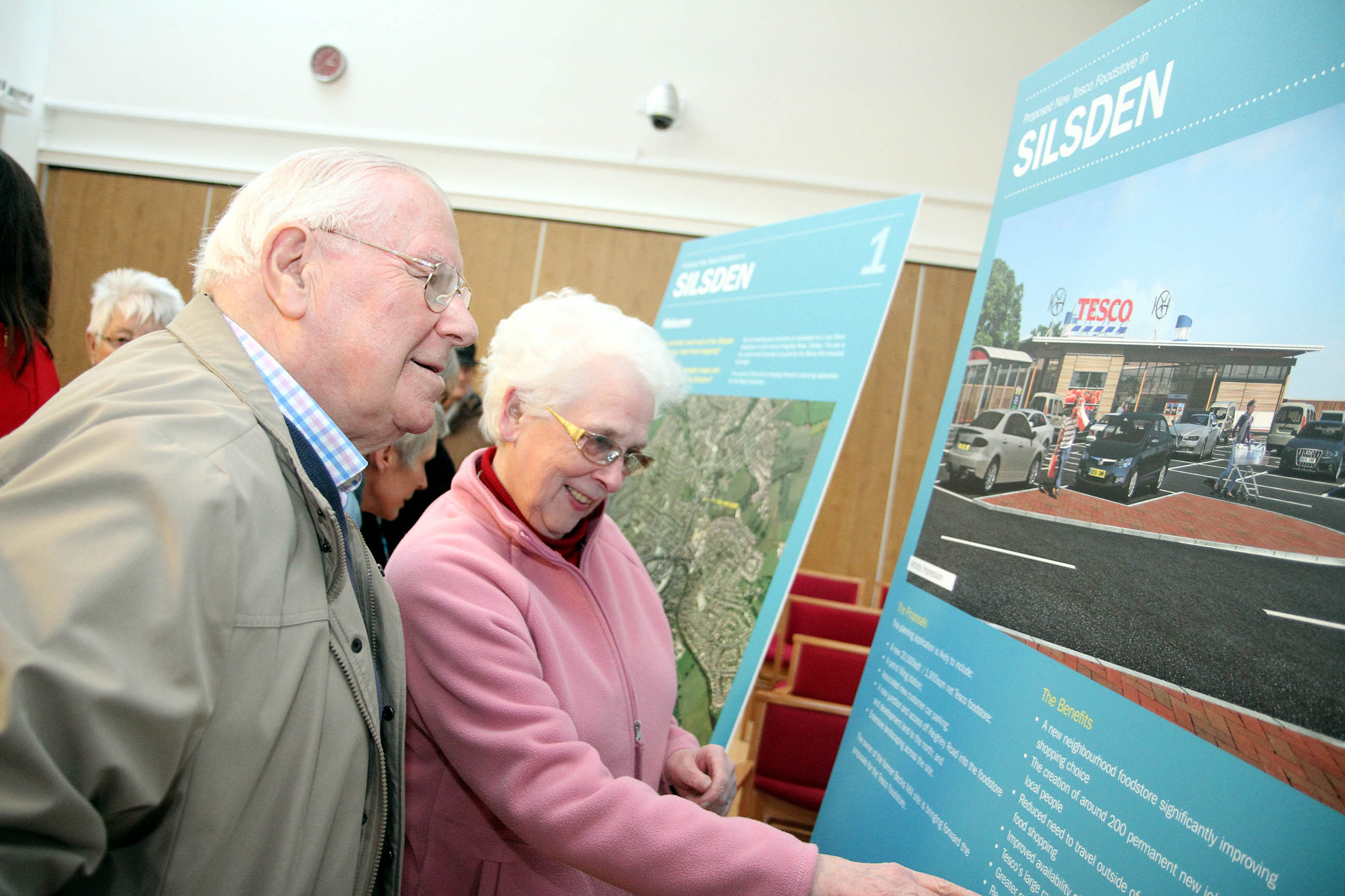 Silsden residents Keith and Brenda Seymour look at the plans for a Tesco  in the town