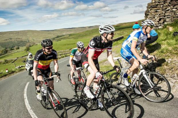 Cyclists tackle Kidstones Pass, with Skipton Cycle club chairman Sean McKibben at the back