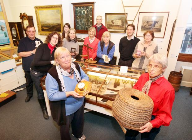 Craven Herald: Craven Museum and Gallery staff with some of the volunteers who give up their time to preserve and exhibit the collections