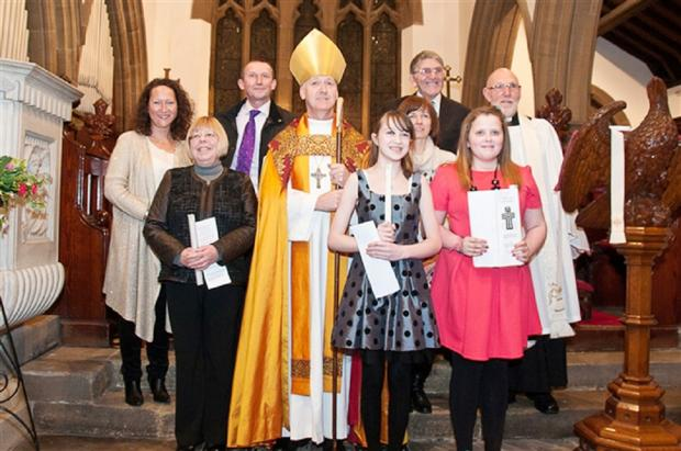 The Bishop of Bradford is pictured with the Rev Canon Michael Cowgill and those who were confirmed.