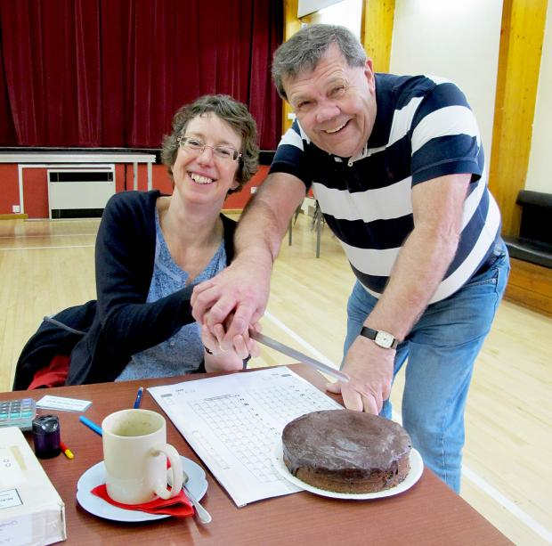 Panto director Liz Cartmell and producer Carl Lis are pictured sampling one of the cakes on sale.